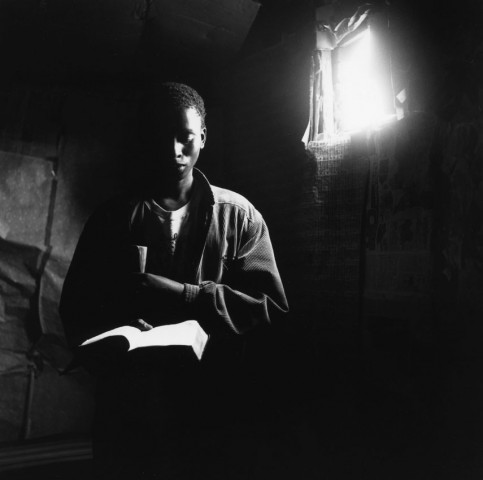 priest in cardboard church in squattercamp, south africa 1992